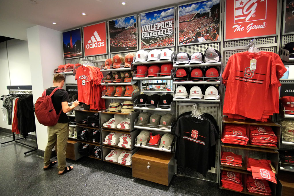 A student browses NC State-branded apparel.