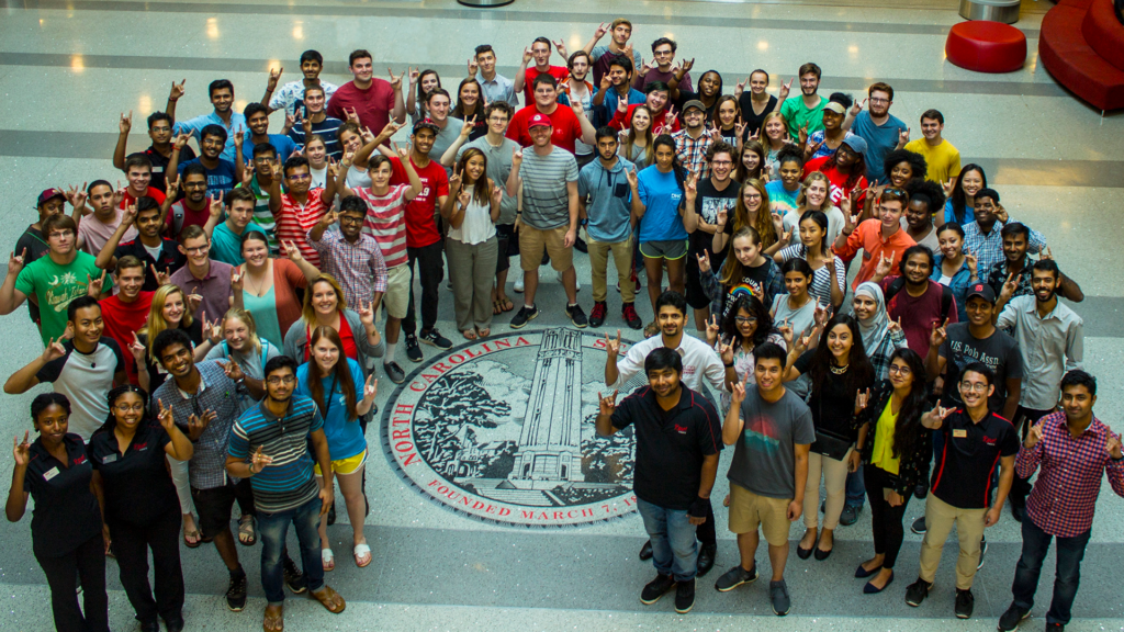 Student Centers employees pose as a group in the Talley Student Center lobby.